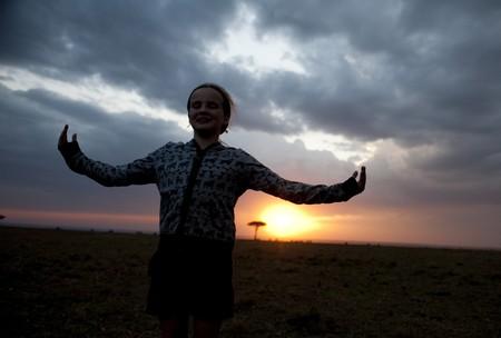 Silhouette of girl against Kenya sky at sunset photo