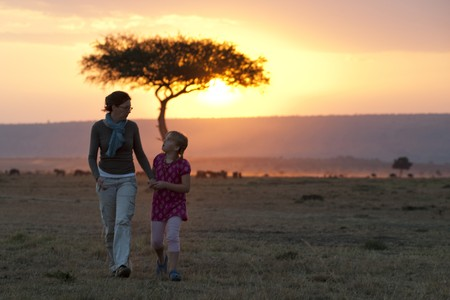 levit: Sillouette of people against sunset sky in Kenya Stock Photo
