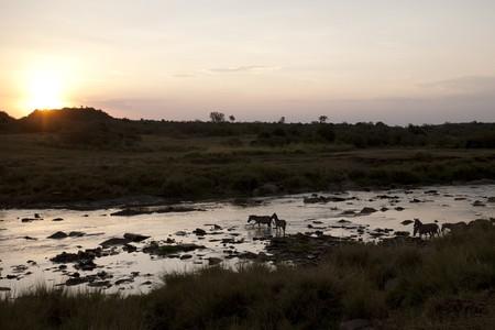 Sunset over river in Kenya photo