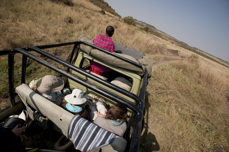 People in safari truck
