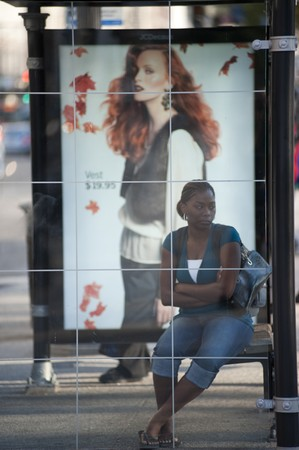 bus stop: Woman waiting at Chicago Bus Stop