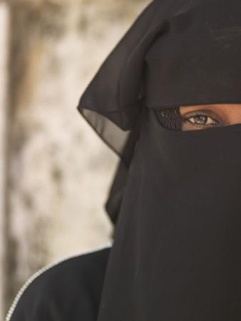 niqab: Muslim woman in Lamu Town, Kenya Africa Editorial
