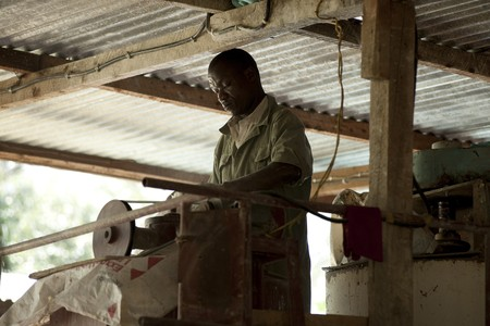 machinery: African man working with machinery Editorial