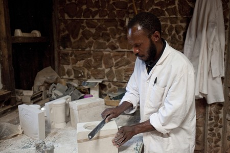 African man working on crafts
