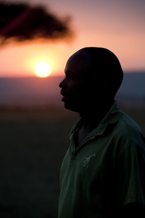 Sillouette of people against sunset sky in Kenya