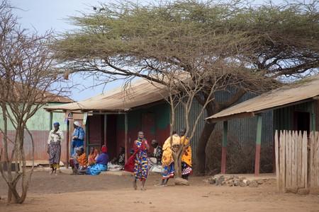 Villagers by hut in Kenya