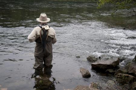 Man fly fishing at lake Taneycomo in Branson, Missouri