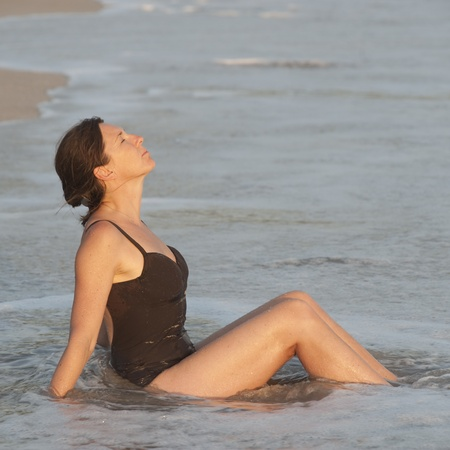 Caucasian woman relaxing in the water along Costa Rica shoreline