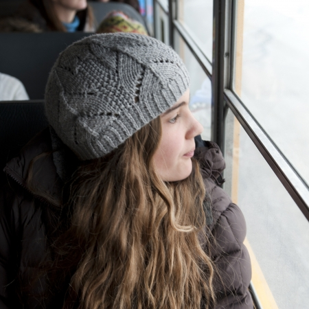 Teen age girl looking through the window of a bus, Churchill, Manitoba, Canada photo
