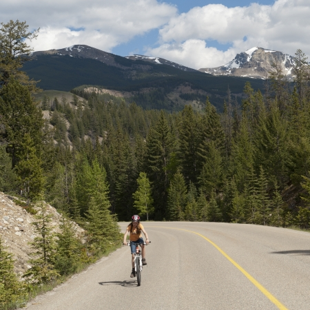 Girl riding a bicycle, Jasper National Park, Alberta, Canada photo