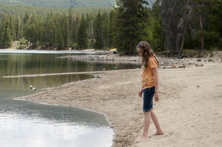 edith: Girl standing at the lakeside, Edith Lake, Jasper National Park, Alberta, Canada