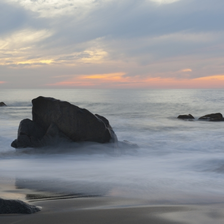 Rocks on the beach, Sayulita, Nayarit, Mexico photo