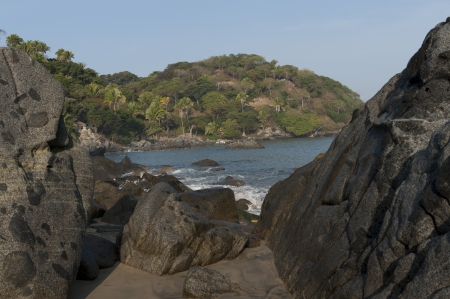 Boulders on a beach, Sayulita, Nayarit, Mexico photo
