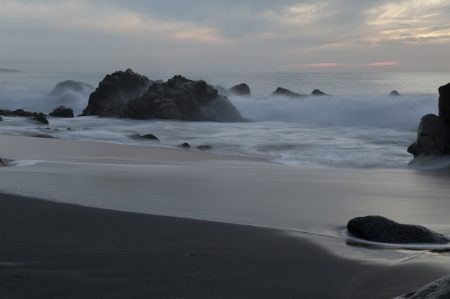 Waves breaking on rocks, Sayulita, Nayarit, Mexico photo