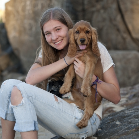 Teenage girl with a dog, Sayulita, Nayarit, Mexico photo