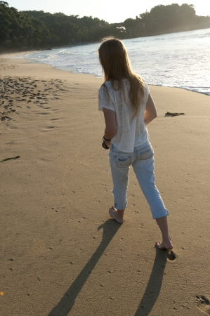top: Teenage girl walking on the beach, Sayulita, Nayarit, Mexico
