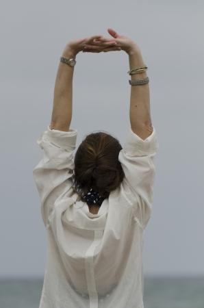 waistup: Woman stretching her arms, Sayulita, Nayarit, Mexico
