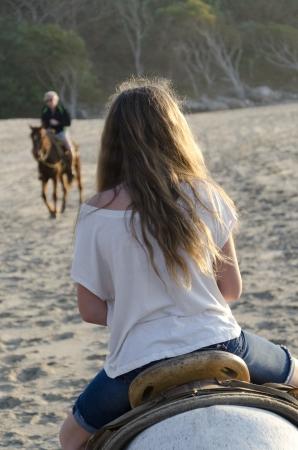 Teenage girl riding a horse on the beach, Sayulita, Nayarit, Mexico Imagens