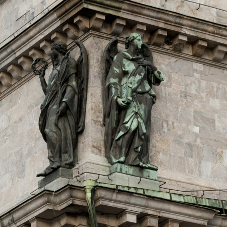 Low angle view of statues on the wall Saint Isaacs Cathedral, St. Petersburg, Russia photo