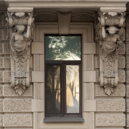female likeness: Carving details on the wall of a building, St. Petersburg, Russia Stock Photo