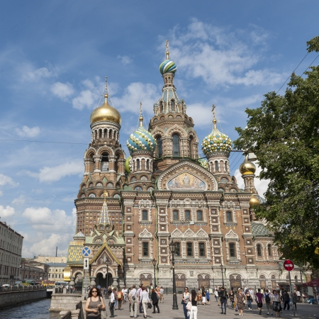 traditionally russian: Tourists outside the Church of the Saviour on Spilled Blood, St. Petersburg, Russia