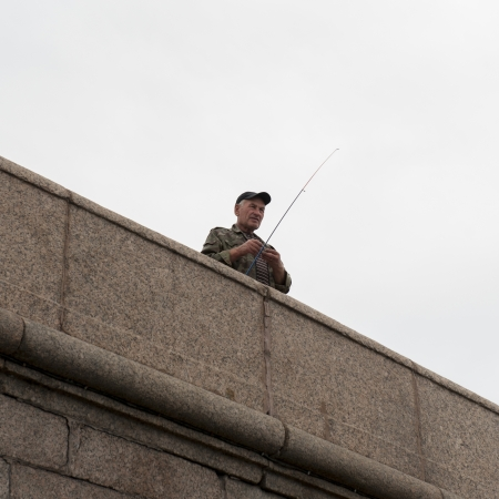 waistup: Low angle view of a man fly-fishing, St. Petersburg, Russia