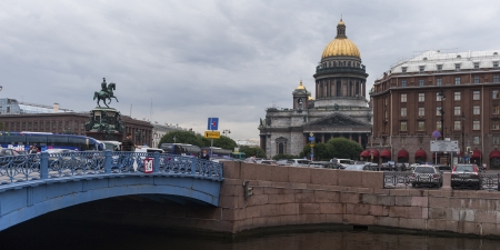 Bridge across the Moyka River with Saint Isaacs Cathedral in the background, St. Petersburg, Russia