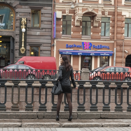 Rear view of a woman looking at traffic in a city, Griboyedov Canal, St. Petersburg, Russia