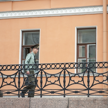 wrought iron: Low angle view of a policeman walking in a street, St. Petersburg, Russia