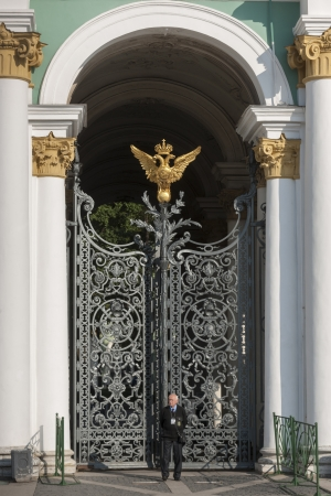 hermitage: Security officer standing in front of a gate of Winter Palace at State Hermitage Museum, Palace Square, St. Petersburg, Russia