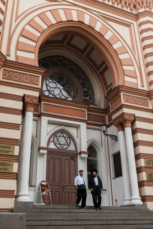 choral: Men moving down steps of the Grand Choral Synagogue, St. Petersburg, Russia Editorial
