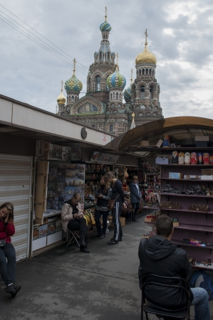 traditionally russian: People in a market with the Church of the Saviour on Spilled Blood in the background, St. Petersburg, Russia