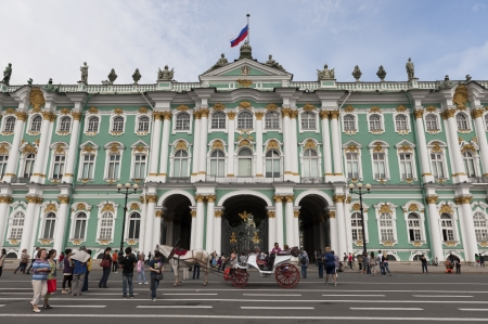 Tourists in front of the Winter Palace, State Hermitage Museum, Palace Square, St. Petersburg, Russia