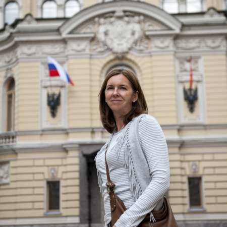Woman standing in front of a government building, St. Petersburg, Russia photo