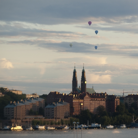 Hot air balloons over a city, Stockholm, Sweden photo