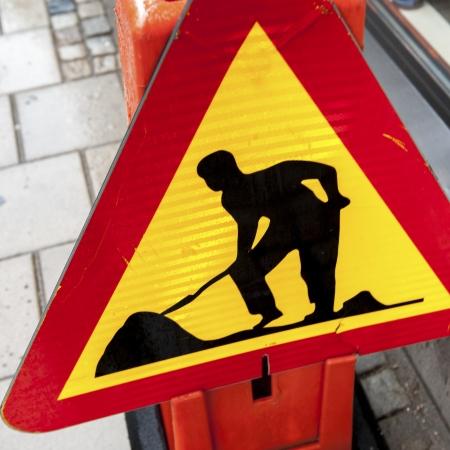 Close-up of 'Men at Work' sign, Uppsala, Sweden Stock Photo - 14200024