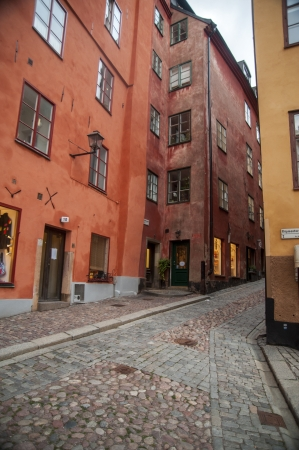 Houses along a cobblestone street in Baggensgatan, Gamla Stan, Stockholm, Sweden photo