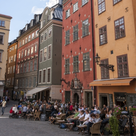 Tourists at outdoor cafes on a street, Gamla Stan, Stockholm, Sweden