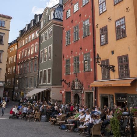 stockholm: Tourists at outdoor cafes on a street, Gamla Stan, Stockholm, Sweden