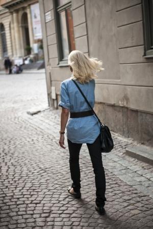 Woman walking on a street, Gamla Stan, Stockholm, Sweden photo