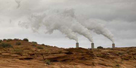 Smoke emerging from chimney stacks, Arizona, USA photo