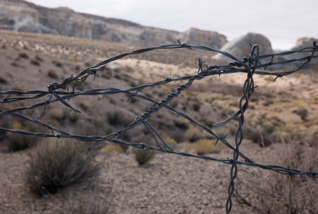 hoodoo: Close-up of a barbed wire fence, Amangiri, Canyon Point, Hoodoo Trail, Utah, USA