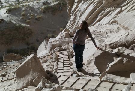 incidental people: Woman standing near cliffs, Ulrikes Cave, Amangiri, Utah, USA Stock Photo