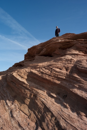 incidental people: Man standing on a rock, Horseshoe Bend, Glen Canyon National Recreation Area, Arizona-Utah, USA
