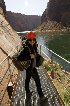 Woman standing on a bridge at Glen Canyon Dam, Glen Canyon National Recreation Area, Arizona-Utah, USA photo