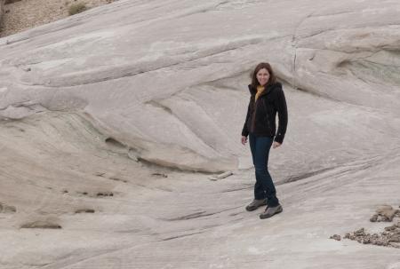hoodoo: Woman standing on a rock, Amangiri, Canyon Point, Hoodoo Trail, Utah, USA Stock Photo