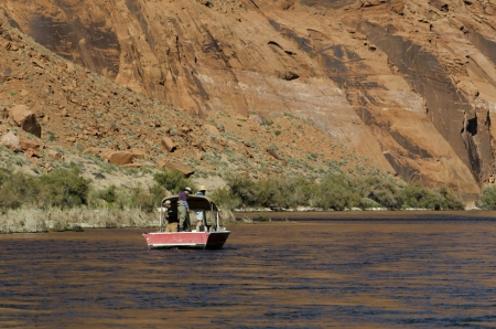 Tourists on a boat in Colorado River, Glen Canyon National Recreation Area, Arizona-Utah, USA photo