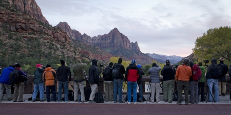 Tourists taking picture of cliffs from an observation point, Utah, USA