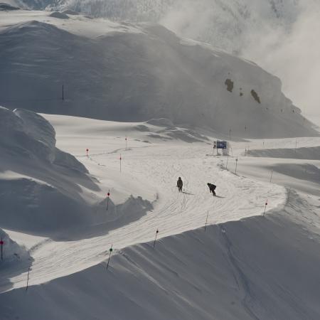 extreme angle: Tourists snowboarding, Whistler, British Columbia, Canada