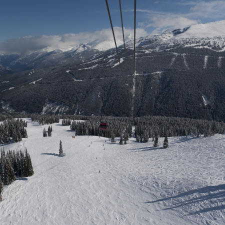 Peak 2 Peak Gondolas over snow covered mountains, Whistler, British Columbia, Canada photo